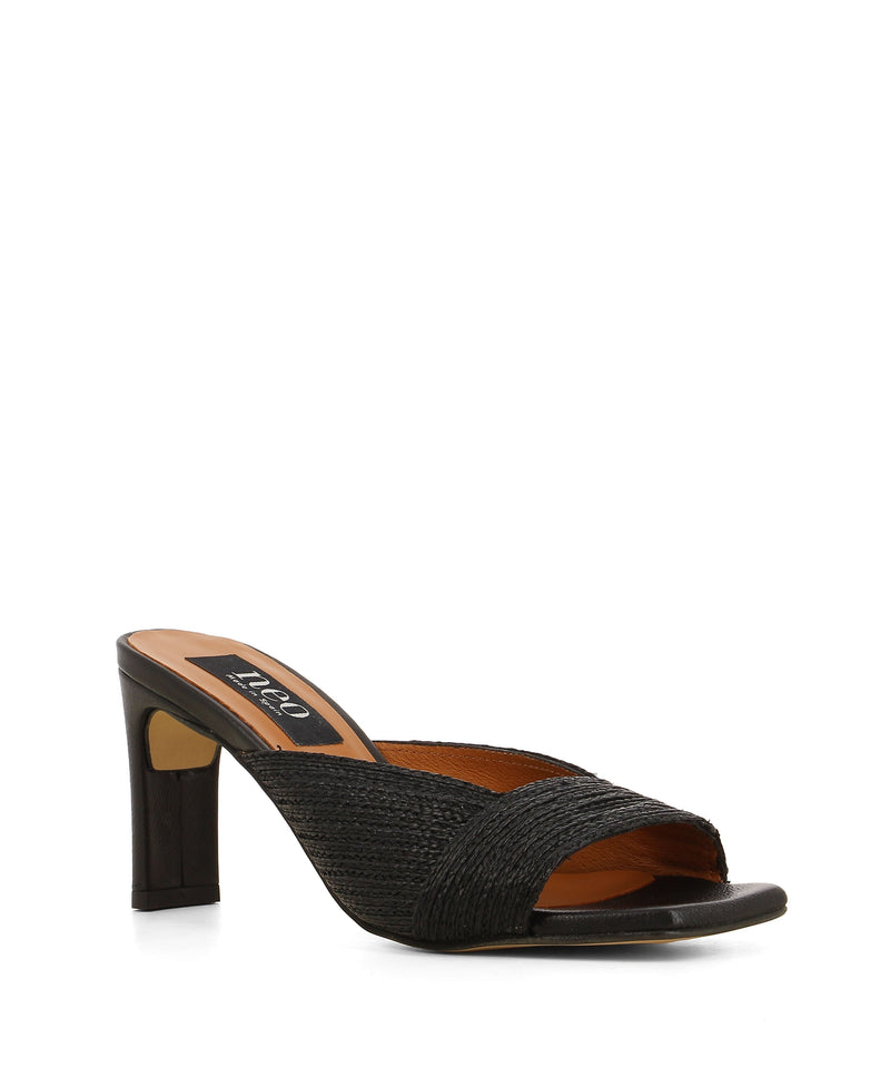 A chic black jute mule that features a woven upper, a tall block heel, and a square open toe by Neo.
