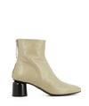 A warm grey Italian leather ankle boot that has zipper fastening and features a 5.5cm black cylindrical block heel and a round toe by Halmanera. This style runs true to size.