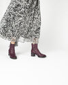 A Italian mulberry coloured leather ankle boot that has dual zipper fastening and features a relaxed upper, a tread sole, a cylindrical 5cm bock heel and a round toe by Halmanera. This style runs true to size.