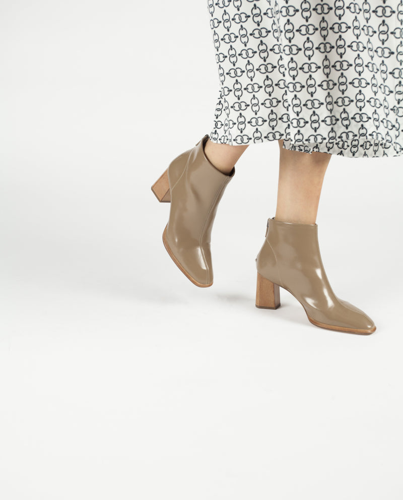 A khaki leather ankle boot featuring a square toe and a contrasting 7cm block heel. Made by Neo X. This style runs true to size.