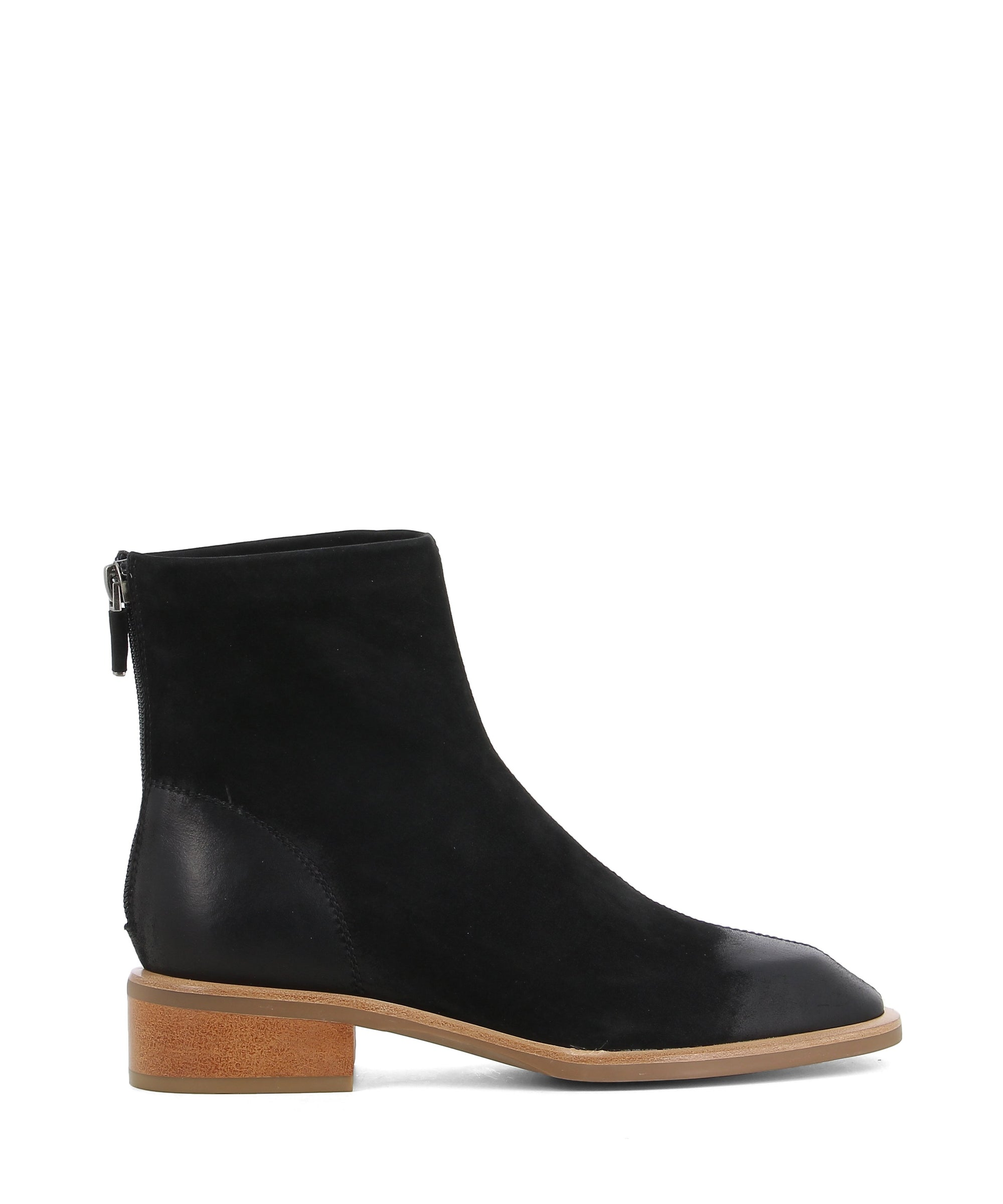 A black nubuck leather ankle by Neo X featuring a burnished round toe, back zipper fastening and a 4cm block heel. This style runs true to size.