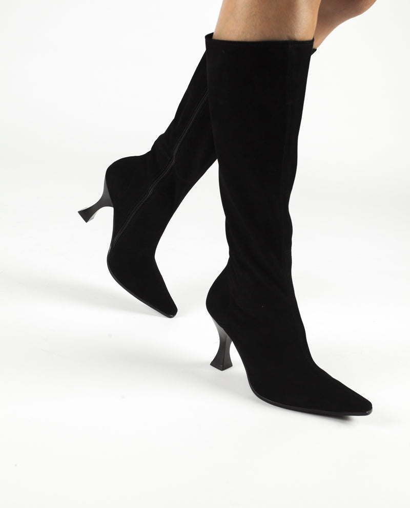 A black suede knee high boot that has zipper fastening and features an architectural 9.5cm heel and a elongated square toe by Jeffrey Campbell.