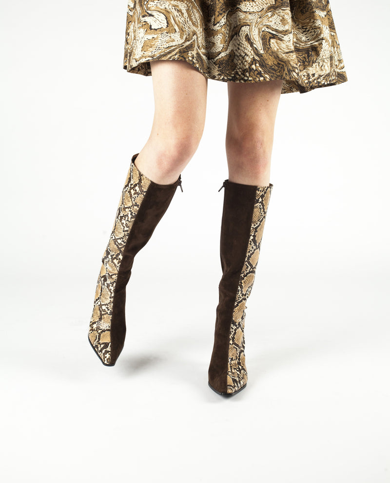 A two tones brown snake skin and brown suede knee high boot that has zipper fastening and features an architectural 9.5cm heel and a elongated square toe by Jeffrey Campbell.