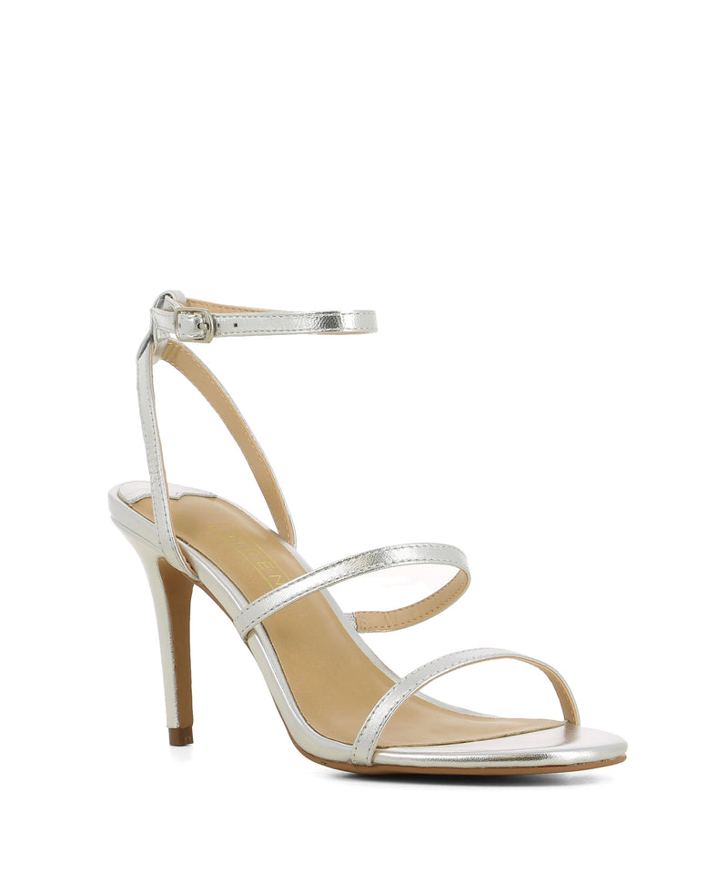 Silver leather strappy heeled sandals that have a silver buckle fastening and features a 9 cm stiletto heel and a round toe by Siren.
