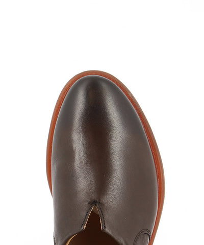 An Italian-made brown leather loafer that features a low 2cm block heel and a almond shaped toe by Zomp.
