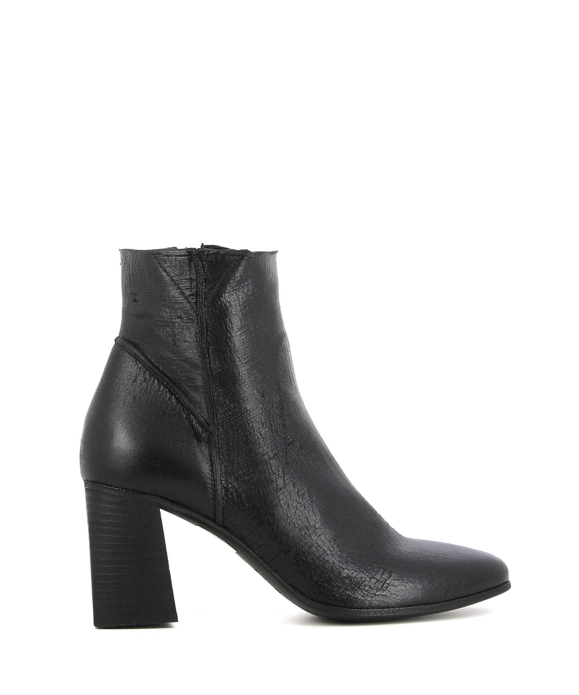 A black Italian leather ankle boot by Elena Iachi. The 'E2331' has zipper fastening and features a laser cut finish to the upper, a black block heel and a almond toe.