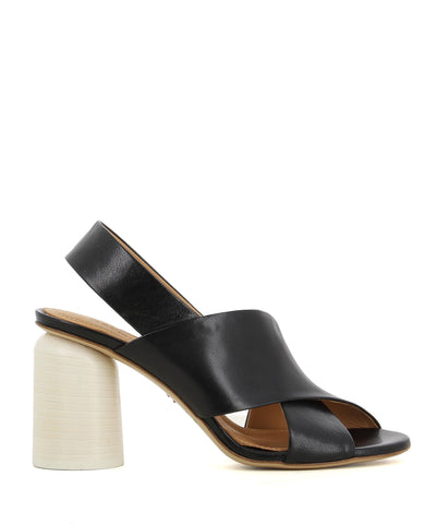 A black Italian leather heeled sandal by Halmanera. The 'Emma04' features cross over straps, a white cylindrical block heel and a round toe.