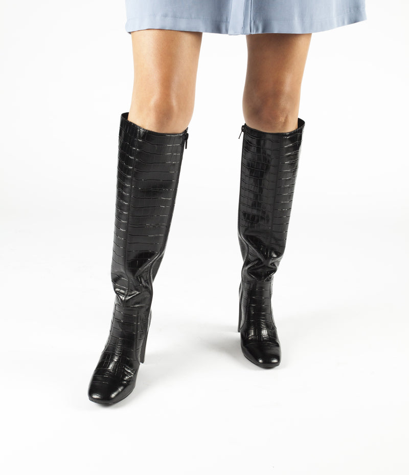 A black croc skin knee high leather boot that has zipper fastening and features a 9.5cm block heel and a square toe by Jeffrey Campbell.