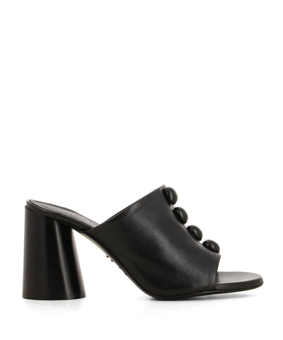An Italian made black leather mule featuring circular domes on the upper, a cylindrical block heel, and a round toe - handmade in Italy by Halmanera. This style runs true to size.