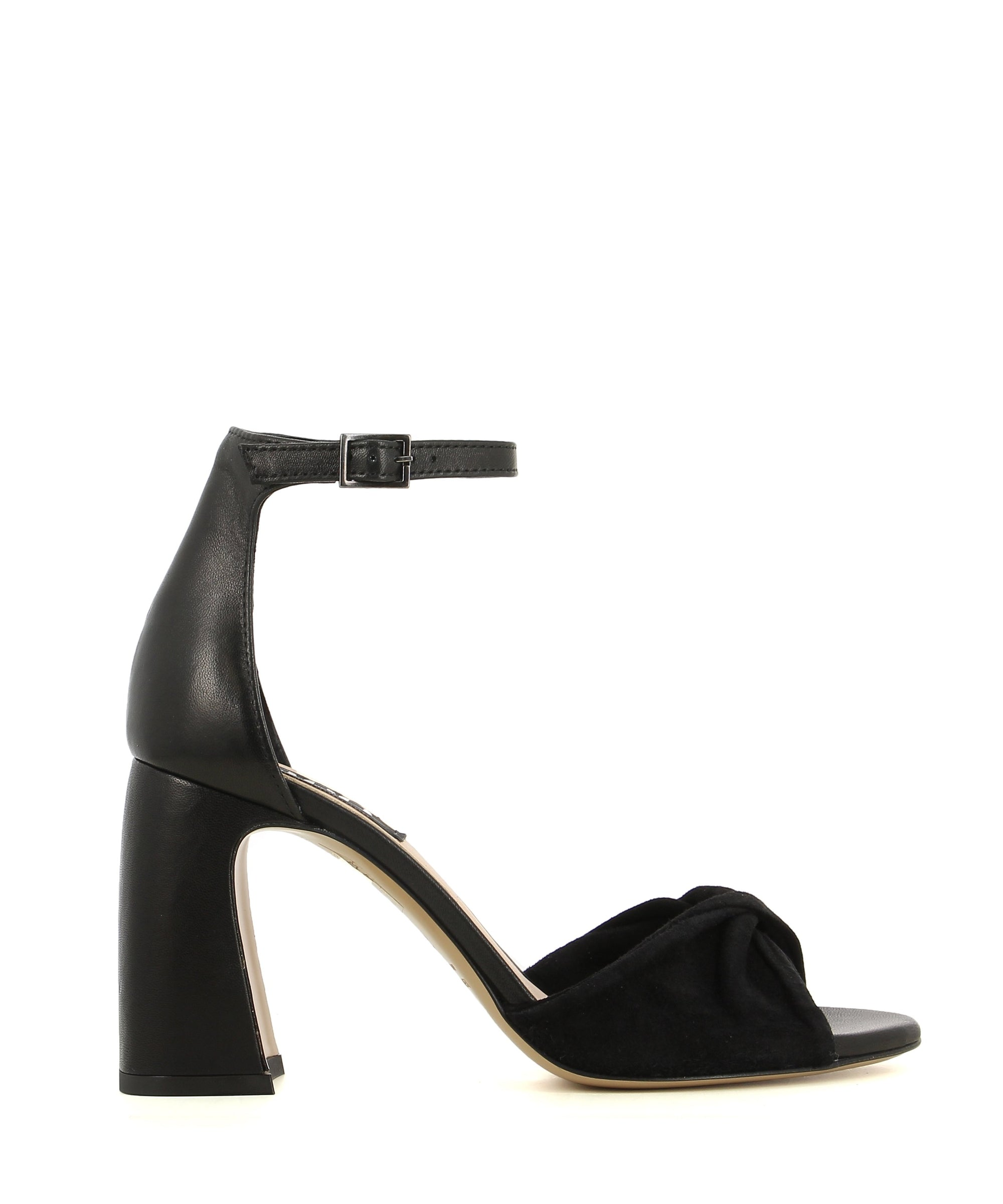 A black leather heeled sandal by Neo. The 'FR-Alyssa6' has an ankle strap with a buckle fastening and features a twisted suede upper, an architectural leather heel and an almond shaped toe.