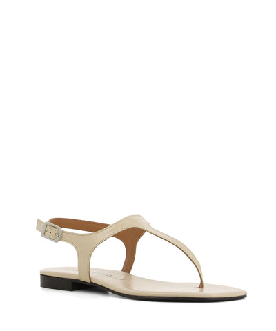 A chic and simple cream leather sandal that has an ankle strap with a silver buckle fastening and features a short block heel and an open square toe by 2 Baia Vista