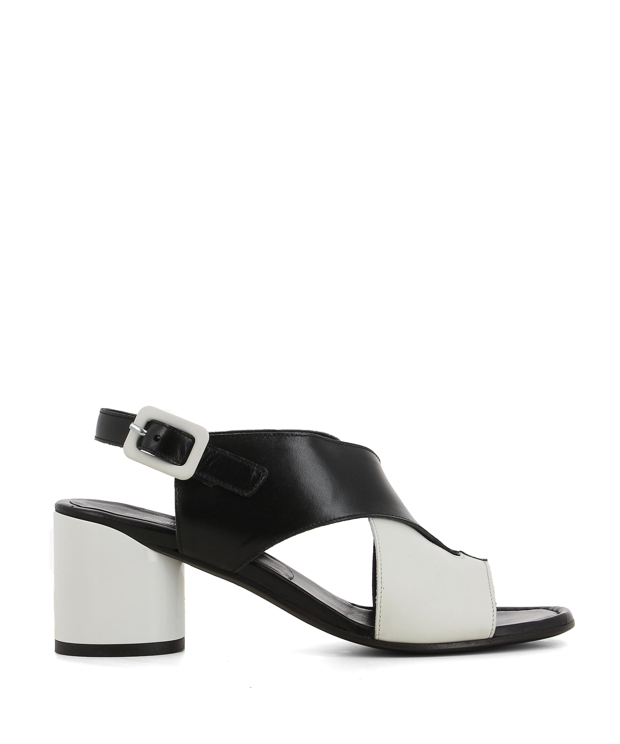 A black and white monochrome two tone leather sandal featuring a 7cm block heel, cross over upper and round toe. Made by Martini Osvaldo - this style runs true to size.