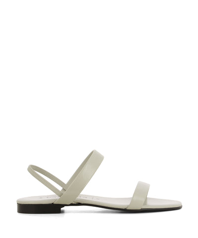 A chic bone coloured leather sandal that has a slingback ankle strap and features a short block heel and an open square toe by 2 Baia Vista.