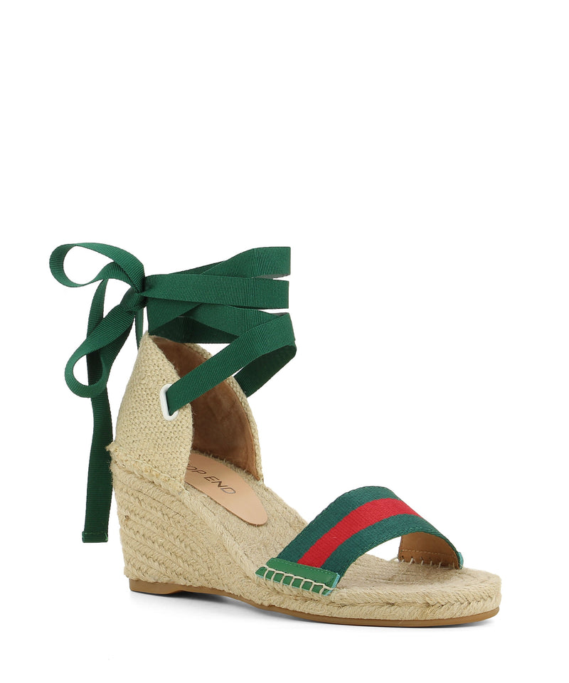 Green and red espadrille sandals that have a ribbon ankle strap and features a jute wedge heel and an open round toe by Top End.