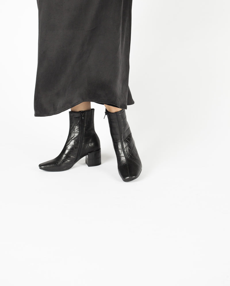 A black croc leather block heel ankle boot. Made by Jeffrey Campbell. This style runs true to size.