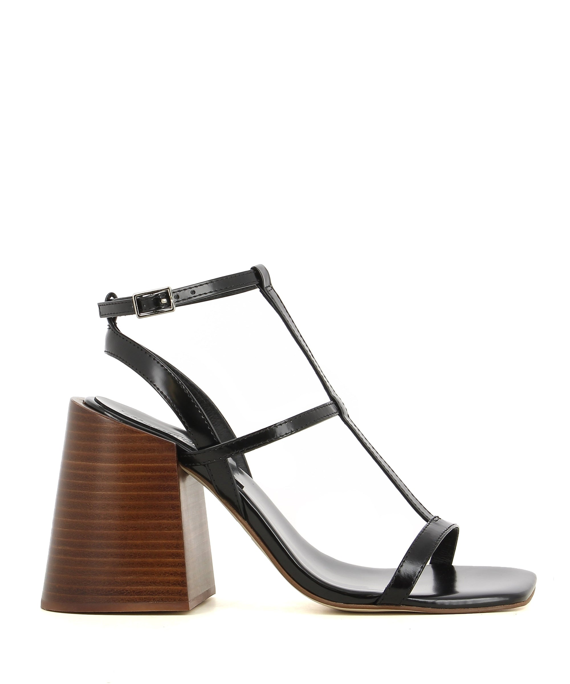 Black patent leather strappy sandals that have buckle fastening and features a high 9 cm chunky wooden heel and a square toe by Jeffrey Campbell.