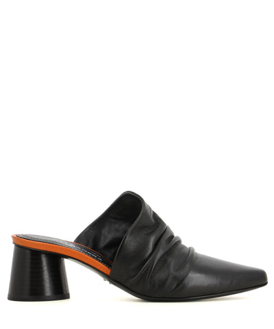 A black leather mule with a block heel and a slouched upper.