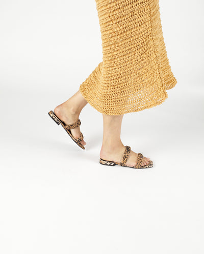 A sleek satin cheetah print sandal by Senso. The 'Harley' features ruched satin straps, and a square toe.