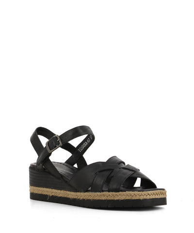 A comfortable black leather wedge sandal that have an ankle strap with a gunmetal buckle fastening and features crossover straps, woven jute trim and an open square toe by Django & Juliette.