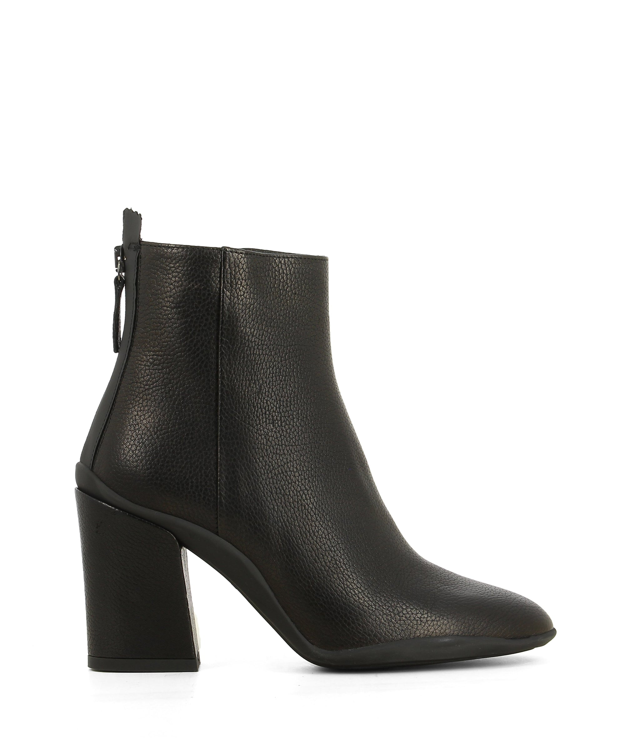 Black leather ankle boots featuring a 8 cm block heel and pointed toe. Handcrafted and made in Italy by Lorenzo Mari. This style runs true to size.