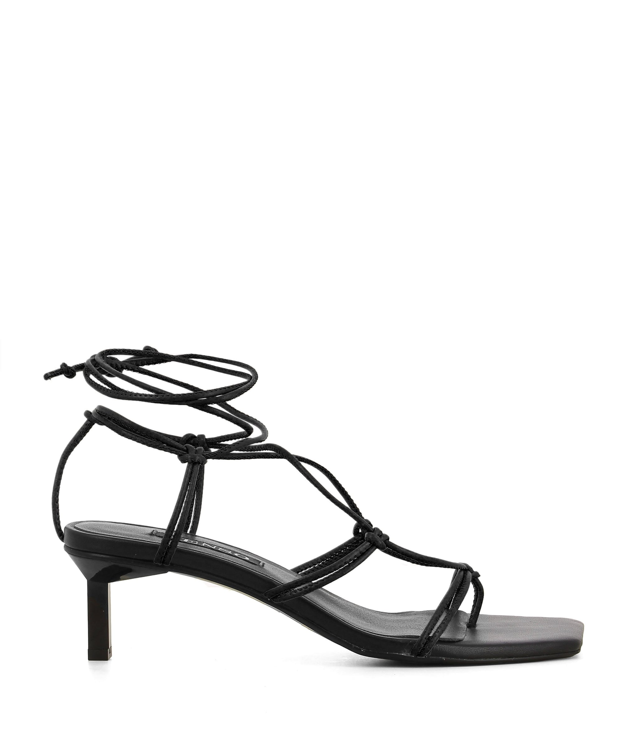 Chic strappy black leather sandals that feature wrap-around ankle fastening, cross over strap detail, a 6 cm kitten heel and a square toe by Senso.