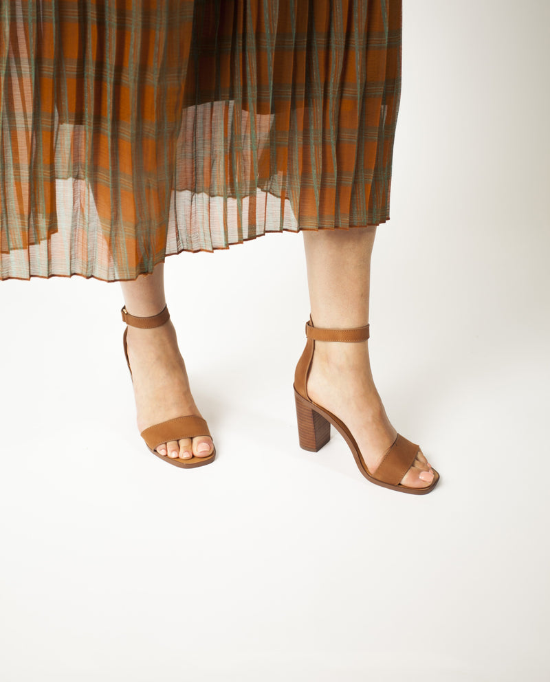 A simple tan heeled sandal by Diavolina. The 'Kano' features a Velcro ankle strap and a soft square toe.