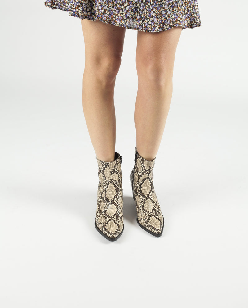 A beige and brown snake skin ankle boot that has zipper fastening, a 6cm block heel and a pointed toe by Jeffrey Campbell.