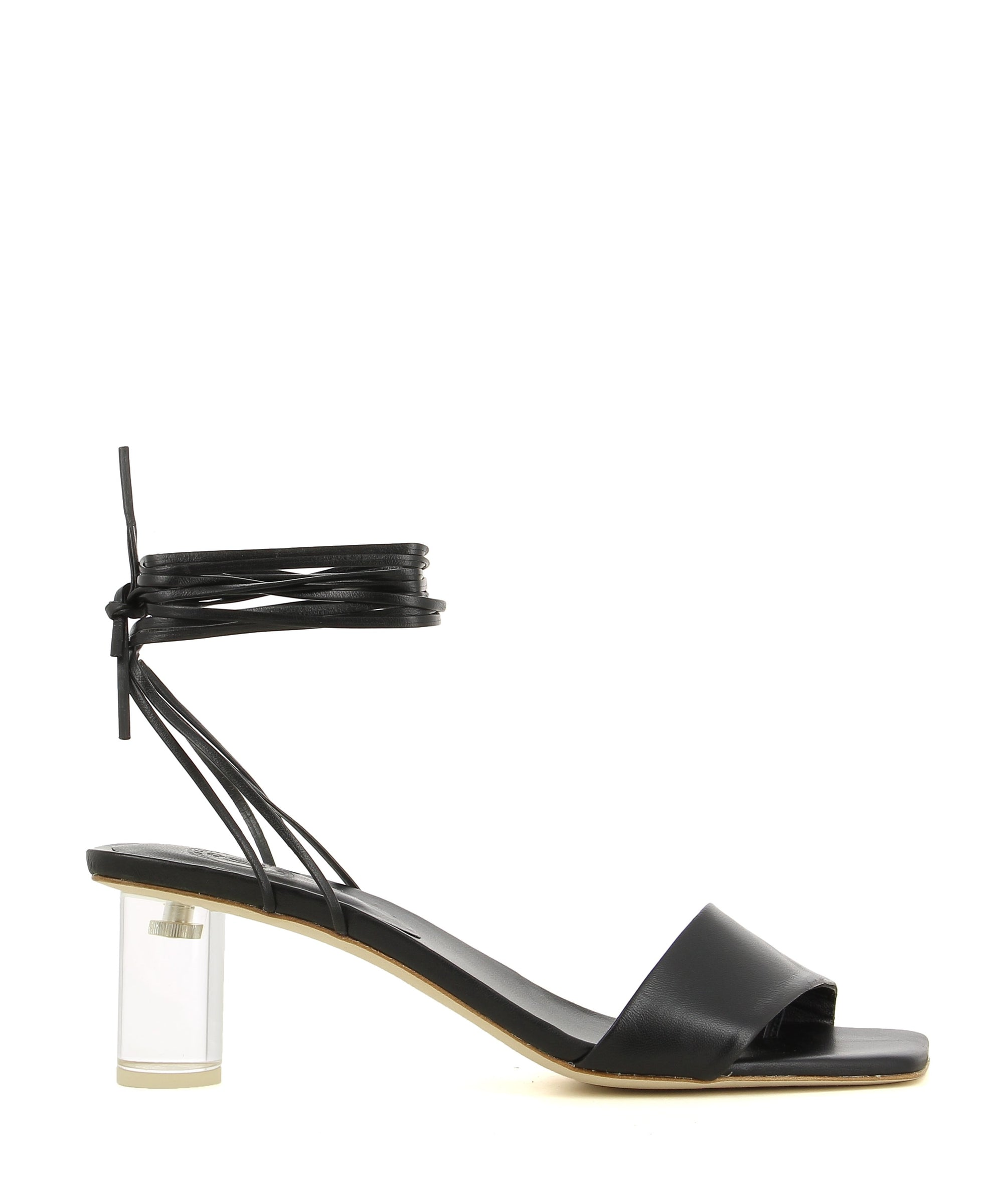 A black leather strappy sandal by Beau Coops. The 'Kim' features a transparent block heel, a wrap around ankle strap and a square toe.