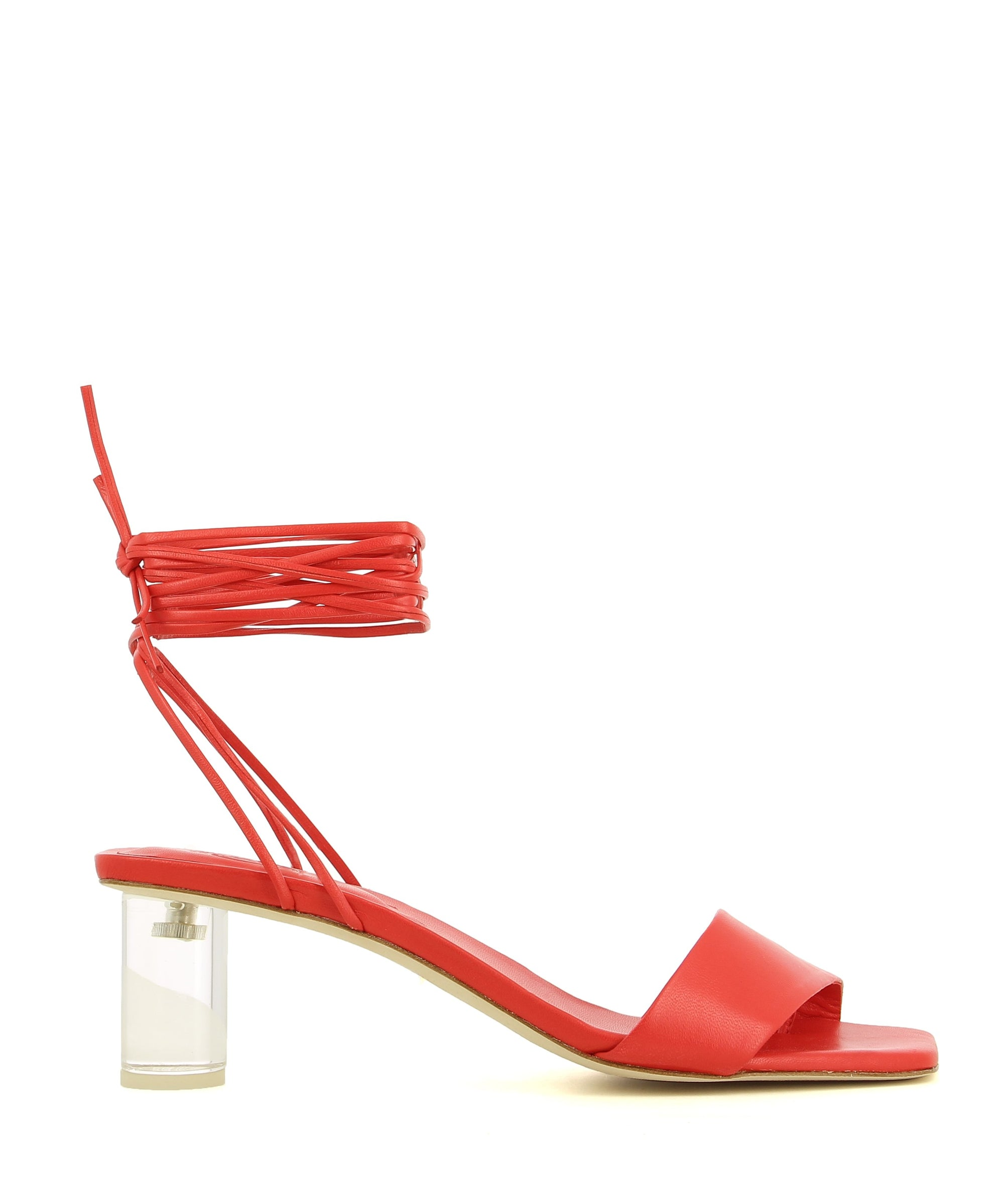 A red leather strappy sandal by Beau Coops. The 'Kim' features a transparent block heel, a wrap around ankle strap and a square toe.