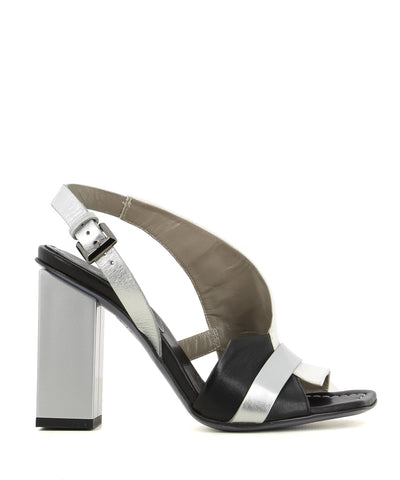 A white, black and silver Italian leather heel that has buckle fastening and features a silver square block heel and a square toe.