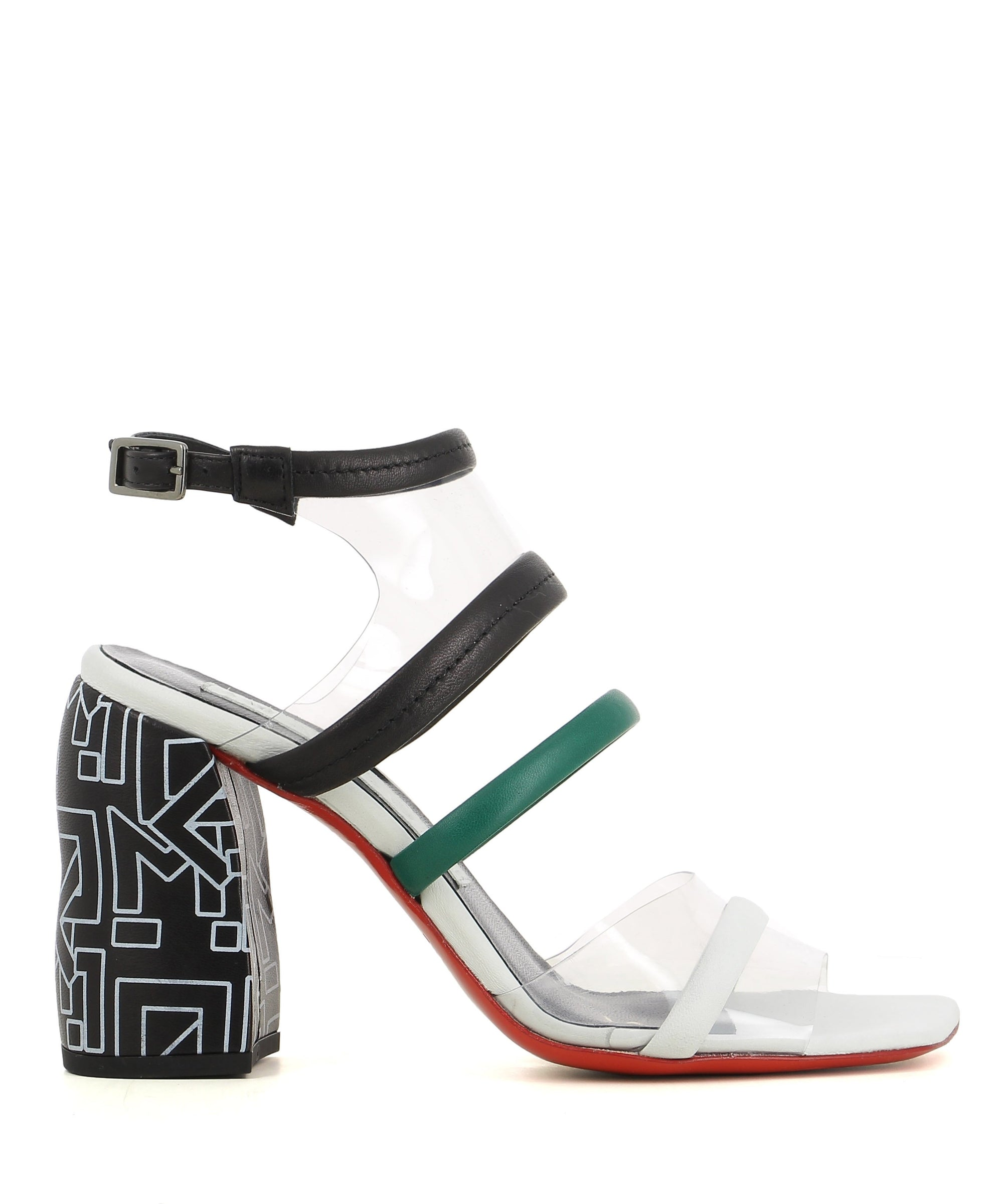 A Italian leather and clear pvc strappy heel with buckle fastening, an illustrated block heel and a square toe.