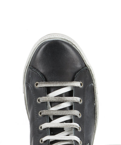 A black and white leather lace up high top fashion sneaker featuring a black star detail and side zipper fastening, made by Tiurai. This style runs true to size.
