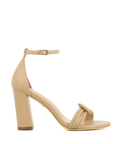A high heeled neutral leather sandal by Robert Robert. The 'Molly' has an ankle strap with a buckle fastening, and features a plaited ropelike upper and a round toe.
