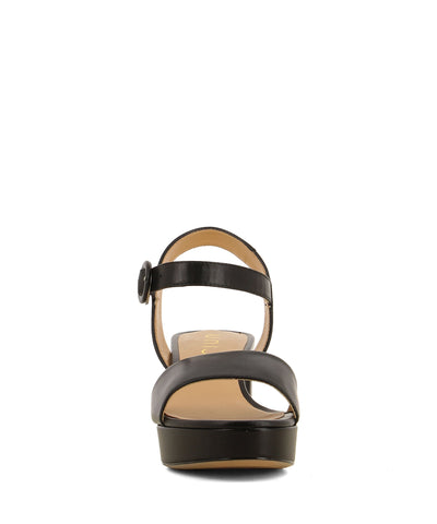 Black leather platform sandals that have a buckle fastening and features a 7cm block heel a round open toe by Unisa.