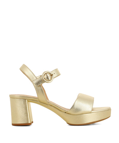 Gold leather platform sandals that have a buckle fastening and features a 7cm block heel a round open toe by Unisa.