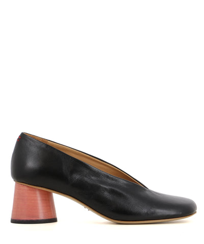 A black leather court shoe with a light pink block heel featuring a angled soft square toe.
