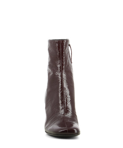 A hand crafted Italian leather mulberry patent leather high heel ankle boot that has a zipper fastening and features a 8cm block heel and a soft square toe by Halmanera. This style runs true to size.