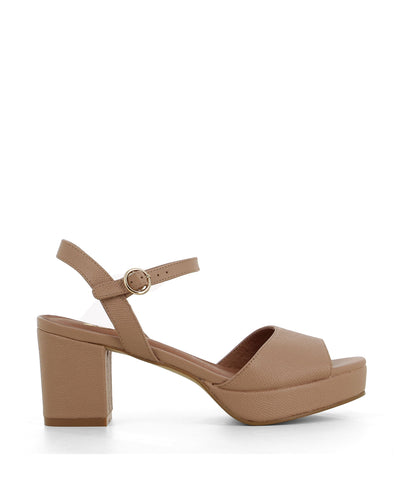 Light dusty pink leather platform, block heeled sandal that features a silver buckle fastening and an open round toe by Zomp.