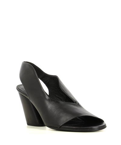 A black Italian leather sling back heel by Halmanera. The 'Ray03' features a wave-cut upper detail, an angled block heel and a open round toe.