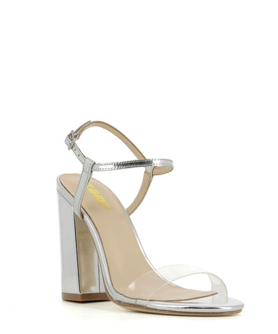 A silver and clear strappy sandal featuring a block heel, ankle strap and an almond shaped toe. Made by ZOMP.