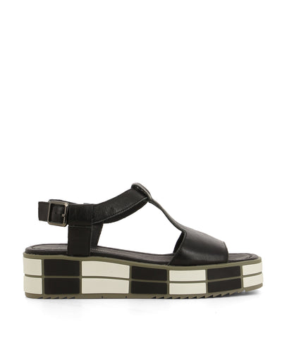 A monochrome black leather t-bar sandal that has an ankle strap with a gunmetal buckle fastening and features a black and white monochrome platform sole and an open square toe by Django & Juliette.