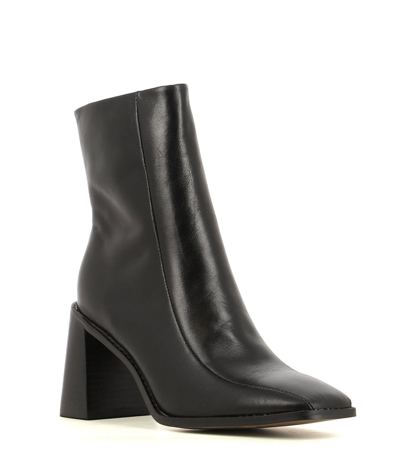Black leather ankle boot with a block heel and square toe. Made by 2 Baia Vista. This style runs true to size.