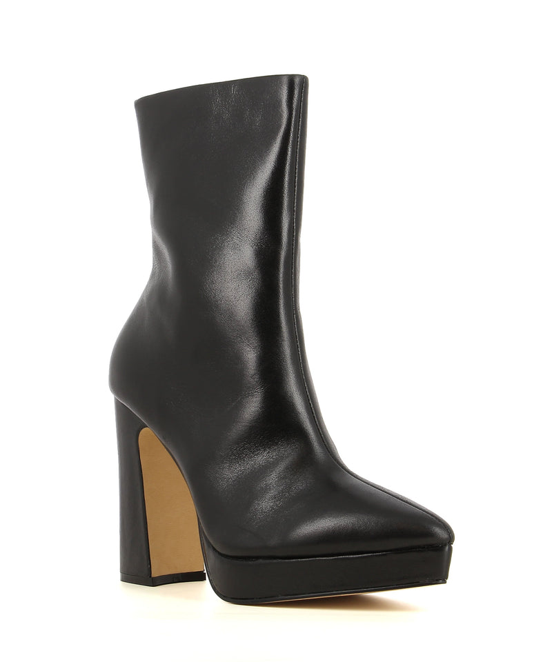 A black leather ankle boot with zipper fastening featuring a block heel, platform sole. and a soft pointed toe.