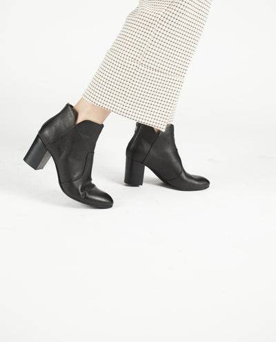 A black leather ankle boot featuring a 6.5cm block heel and almond shaped toe. Made by Top End. This style runs true to size.