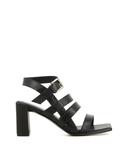 A black leather strappy heeled sandal by 2 Baia Vista. The 'Val' has a silver buckle fastening and features a block heel and a hard square toe.