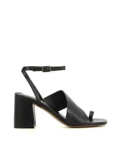 A black leather heel that has a buckle fastening and features a snake printed leather strap over the arch, a clear PVC panel, a toe loop, a 8.5cm block heel, and a square toe by 2 Baia Vista. This style runs true to size.