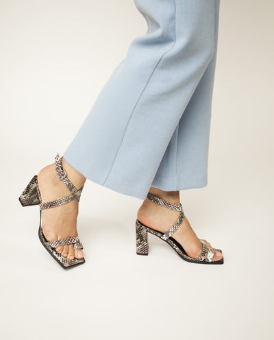 A snake skin like leather heeled sandal by 2 Baia Vista. The 'Valley' has an ankle strap with a silver buckle fastening, and features a block heel and a square toe.