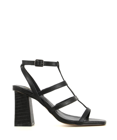 A black heeled sandal featuring a lizard look finish, a t-bar cage strap, a buckle fastenings and a square toe. Made by ZOMP. This style runs true to size.
