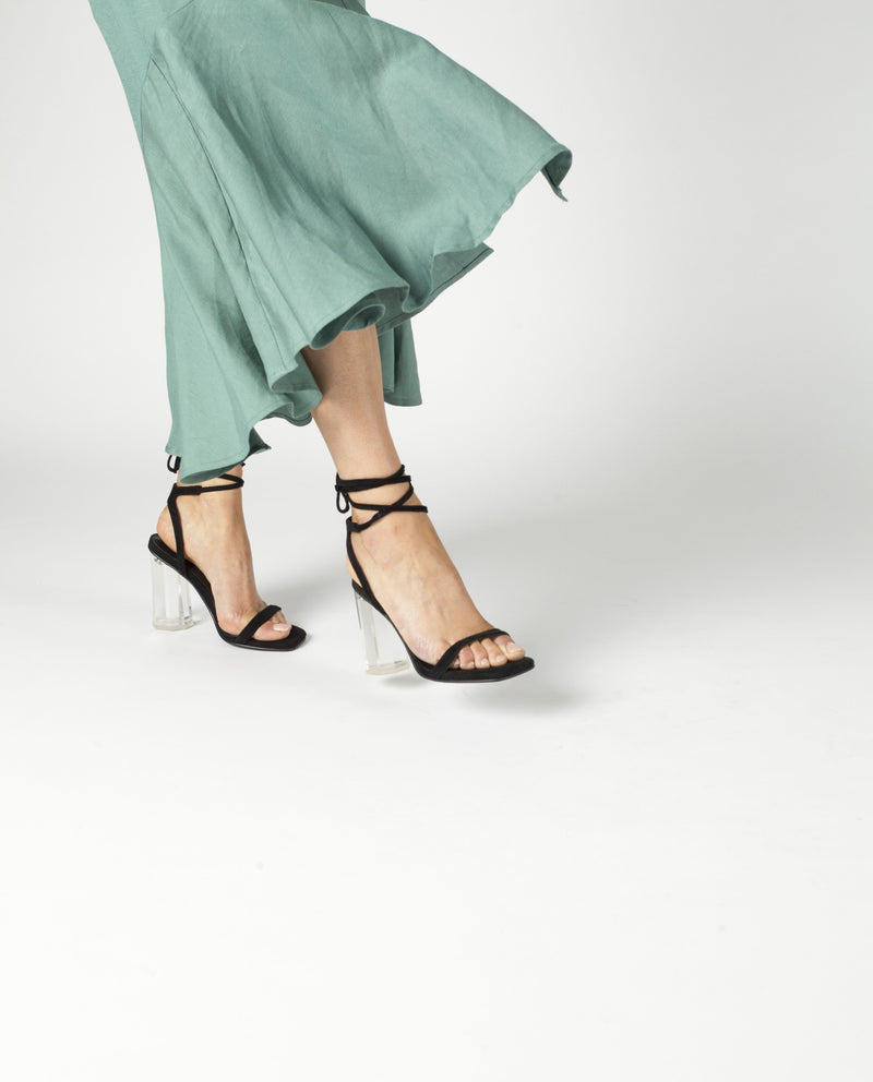 A strappy black suede sandal by Senso. The 'Vee' has a ankle wrap around tie fastening and features a clear acrylic block heel and a square toe.