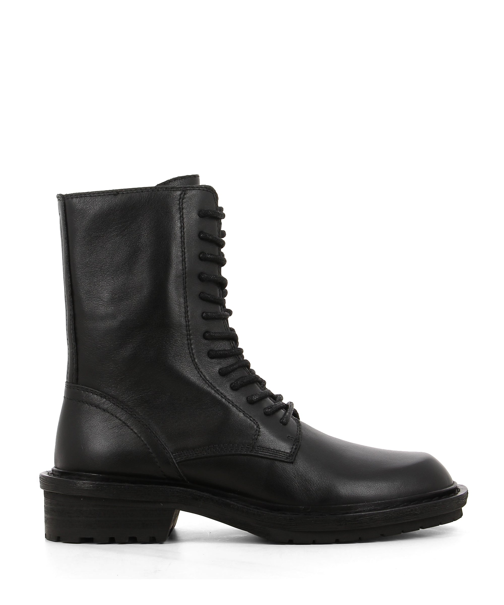 Black leather lace up combat boots with zipper fastenings, a block heel and a rounded toe by 2 Baia Vista.
